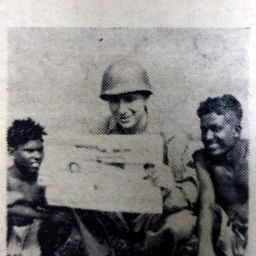 Tech. Sgt. Edwin C. Keys Reading the Herald in India