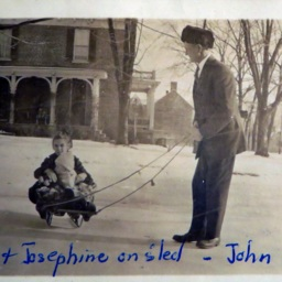 Ruby and Josephine on sled with John Hoshour