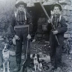 Unidentified Men and Dogs